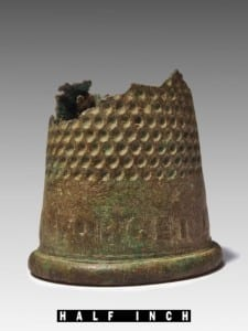 "This thimble has the words ""Forget Me Not"" on it. It was likely used by enslaved or tenant women while they mended clothes near the site of the Duplex. It also carries a message for us: don't forget the lives of those who lived and worked in our historic buildings (photo courtesy of Historic St. Mary's City)."