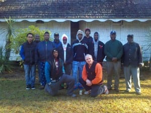Members of the group My Brother's Keeper in front of the slave cabin at Hopsewee Plantation in Georgetown County, SC