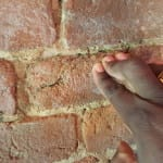 Finger imprints in the bricks at the Coachman's Quarters