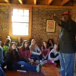 Terry James presenting to the students inside the Coachman's Quarters