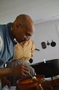 Jerome Bias preparing the sweet potato pone.